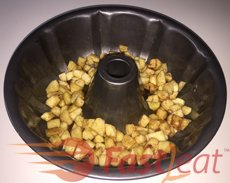 Pour the mix of chopped apples into the prepared Tube Cake pan and them the batter.