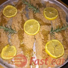 Place fish fillets in the baking pan, and drizzle with olive oil or spray the fillets with cooking spray so that they would crisp nicely.