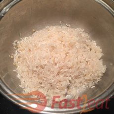 """Add the dry rice to the pan and stir (a practice known as """"refogar"""") until there is no more water, making sure that the rice does not stick to the bottom of the pan (do NOT let brown). That seals the grain and also lubricates it, guaranteeing a loose rice at the end."""
